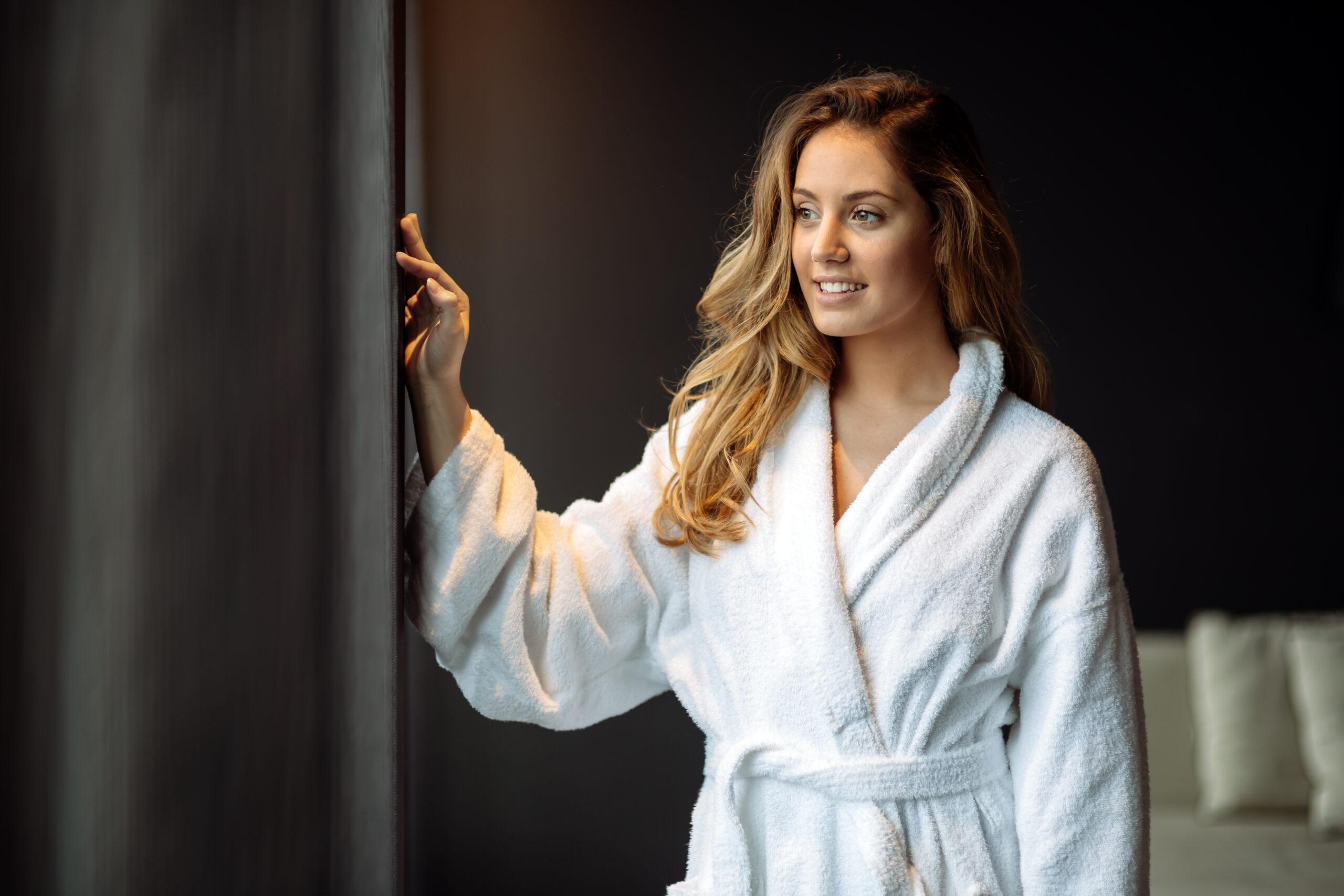 Stunning woman in bathrobe enjoying wellness weekend
